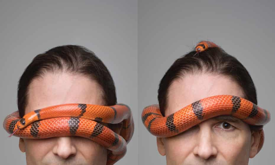 Steve Ludwin with a snake round his head