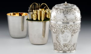 A silver vessel made by Ebenezer Oliphant, containing cutlery, a corkscrew, a marrow scoop and a nutmeg grater.