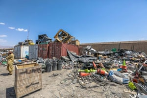 Afghan scrap dealers buy items which were discarded by the US forces outside Bagram