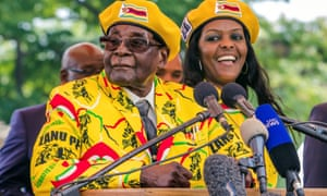 Zimbabwe's president Robert Mugabe addresses Zanu-PF members gathered to show support for Grace Mugabe, right, becoming the party's next vice president.