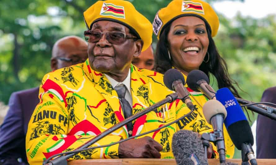 Robert Mugabe addresses Zanu-PF members gathered to show support for his wife, Grace, right, to become the party's next vice-president.