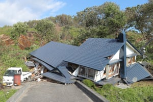 A house hit by a landslide in Atsuma