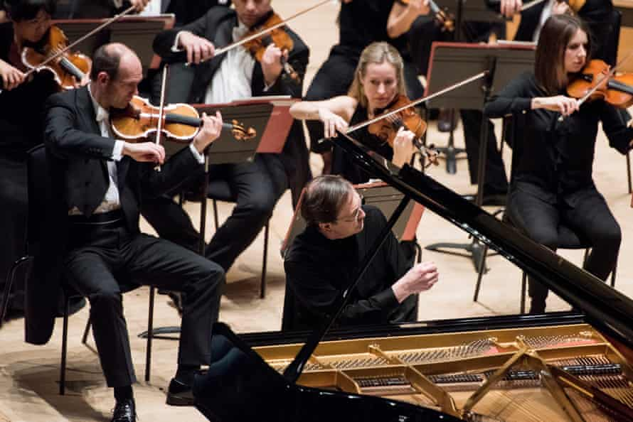 Pierre-Laurent Aimard, front, with the Philharmonia Orchestra.