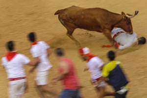 Pamplona, Spain A reveller is floored during the running of the bulls
