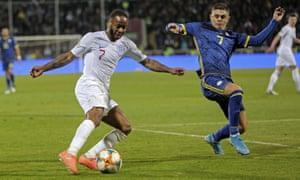 Raheem Sterling and Kosovo's Milot Rashica challenge for the ball.