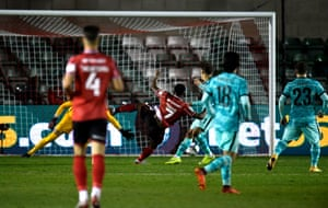 Lincoln City's Tayo Edun scores his side's first goal.