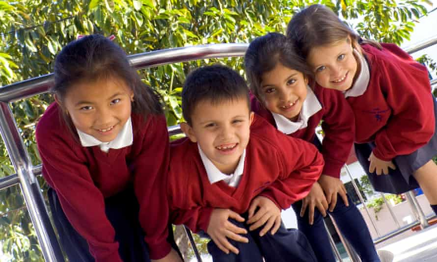 Happy group of children smile to camera at playtime
