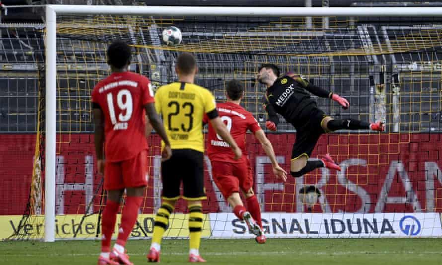 Borussia Dortmund's Roman Bürki cannot stop Joshua Kimmich's chip for Bayern Munich