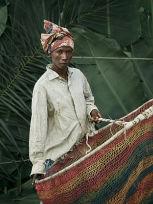 Massa Kanie, holding homemade hooped nets used for fishing