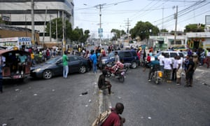 Residents block a street with their cars in a protest at fuel shortages in Port-au-Prince.