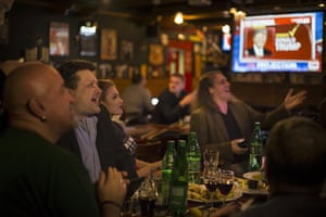 Political experts react as they watch a live telecast of the US presidential election in the Union Jack pub