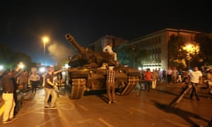 Civilians climb on to a tank as they resist an attempted military coup in Ankara last year.