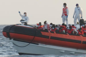 The patrol boat of the Italian Coast Guard is loaded with rescued migrants on its way to desembark at the port in Lampedusa, Italy, on 30 August 2020.