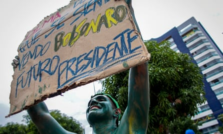A man with his body painted in green holds a placard supporting a possible candidacy of militarist congressman Jair Bolsonaro to the presidency during a demonstration against Brazilian President Dilma Rousseff.