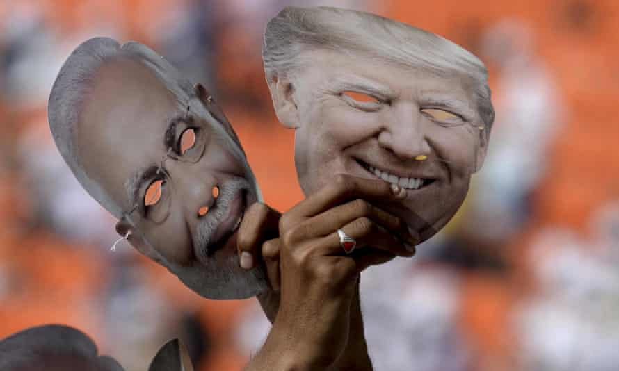 Indians hold masks of Donald Trump and Narendra Modi at the Sardar Patel Gujarat Stadium in Ahmedabad in February 2020.