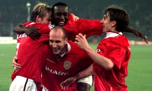 Manchester United players Dwight Yorke (centre), David Beckham (left) Jaap Stam (bottom) and Gary Neville celebrate their victory.
