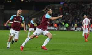 West Ham United's Andy Carroll celebrates scoring a late equaliser.