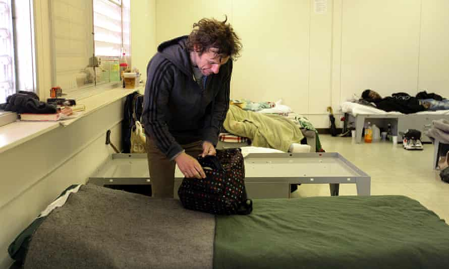 John Rao packs a bag by his bed in the navigation center in the Mission district in San Francisco.
