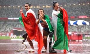 Bronze medalist Monica Graziana Contrafatto, gold medalist Ambra Sabatini and silver medalist Martina Caironi of Team Italy in the 100m T63 final.