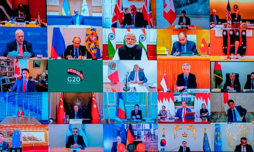 A television screen at the Palazzo Chigi in Rome shows a video conference between G20 leaders
