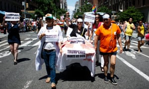 People protest the proposed Republican healthcare legislation during the annual New York Pride march in New York City on Sunday.