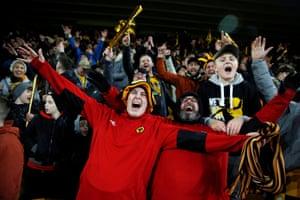 Wolverhampton Wanderers fans celebrate inside the stadium.
