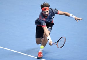 Ferrer returns with a backhand.