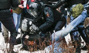 Riot police detain a demonstrator with a bloody face in Pushkin Square, Moscow