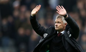 Ole Gunnar Solskjær waves to fans after the match.