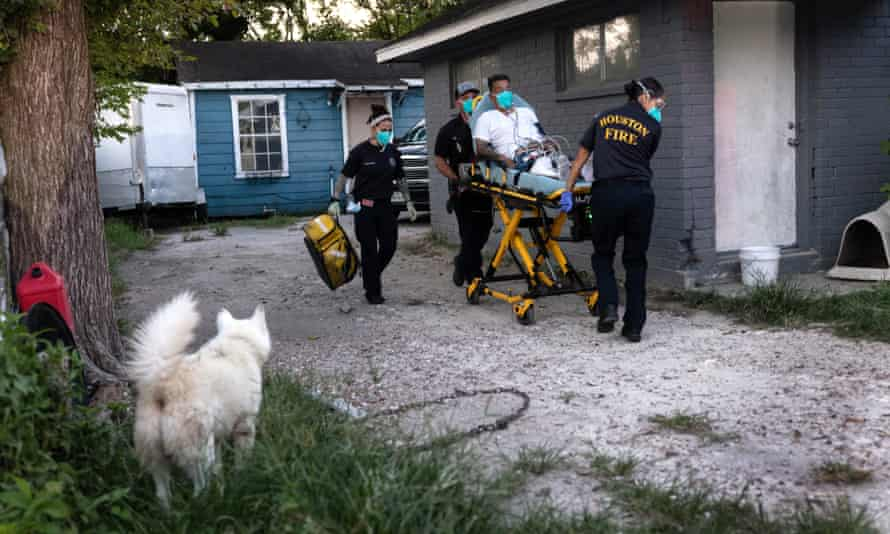 Paramedics transport a man with Covid symptoms to a hospital in Houston, Texas