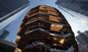 Vessel, a 150ft-tall structure of climbable interlocking staircase, rises above Hudson Yards in New York.