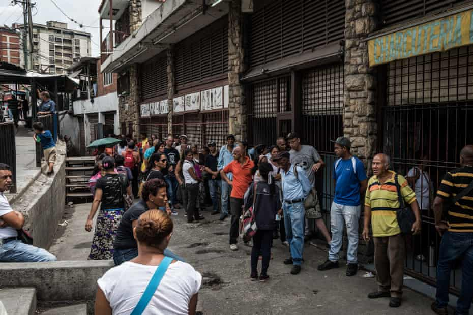 People queue up in the morning in front of a small market to try and buy food. Endless queues have become a daily reality for Venezuelans. In many cases, the cargo doesn't arrive or is not enough