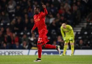 Divock Origi celebrates scoring Liverpool's third.