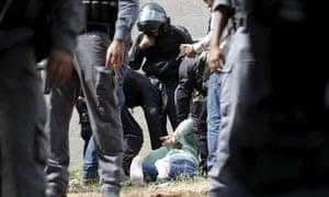 Israeli police detain a Palestinian man suspected of stabbing an Israeli in Jerusalem on 9 October, 2015.