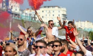 England's unexpected run to the semi-finals has led to joyous scenes back home, like this one on Brighton beach.