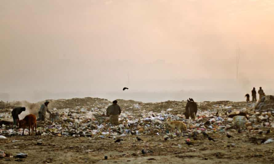 Sifting to survive … a community lives on a rubbish dump in Kathmandu, Nepal.