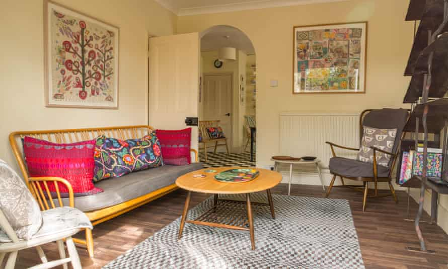 Ercol furniture, Margot Selby cushions and a steel bookcase in the day room.