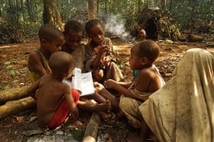 Ba'aka children enact the daily hunting ceremony