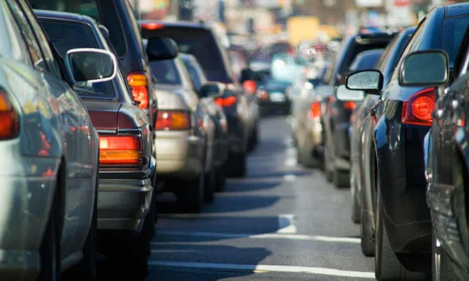 Cars brake in a traffic jam