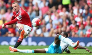 Wayne Rooney shoots at goal.