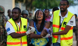 A woman is rescued after being held hostage by armed men in Garissa University in April.