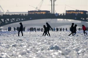 St Petersburg, Russia. People walk on the frozen Neva river in the centre of the city