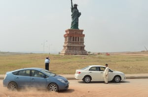 A replica stands at the roadside at the Bahria Town private development in Rawalpindi, Pakistan