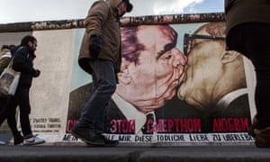 A mural on a remnant of the Berlin Wall depicts Leonid Brezhnev kissing former communist East German leader Erich Honecker.