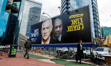 A Blue and White party billboard showing, left, Benny Gantz, with text reading 'taking care of Israel' and, right, Benjamin Netanyahu with text reading 'taking care of himself'.