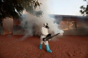 A member of local hygiene services disinfects an empty school to stop the spread of coronavirus.