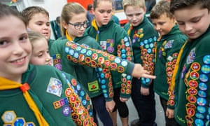 Cubs from the West Hoathly group show off their badges.