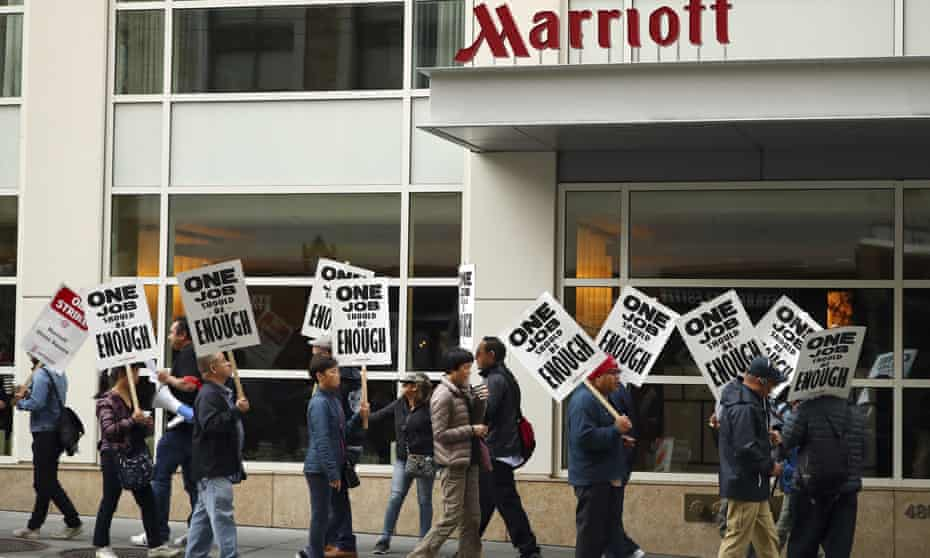 Striking hotel workers picket in front of a Marriott hotel in San Francisco earlier this month.