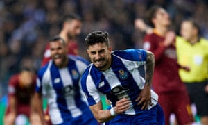 Porto's Alex Telles celebrates scoring a VAR penalty in extra time to eliminate Roma.
