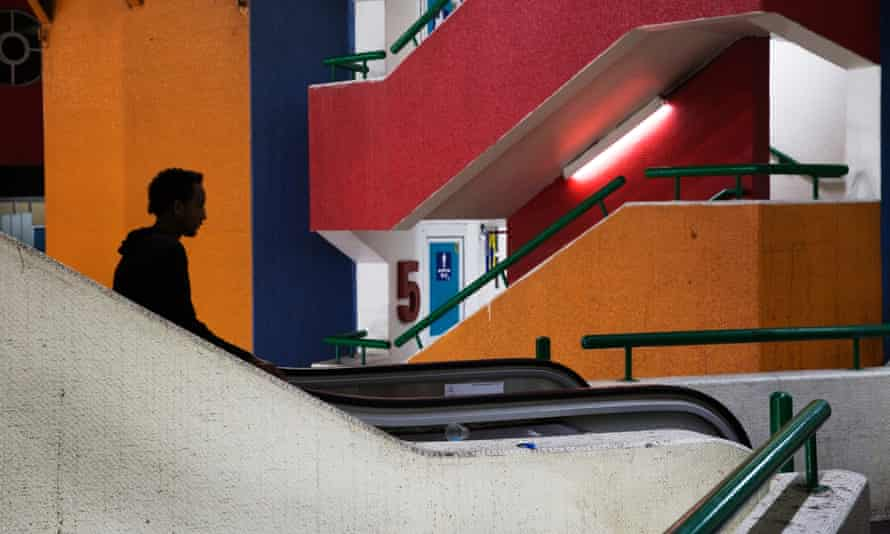 An African migrant rides an escalator at the Central Bus station in Tel Aviv, October 21, 2014
